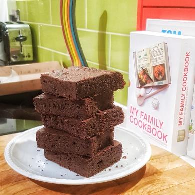 Stack of five fudgilicious London Keto Brownies